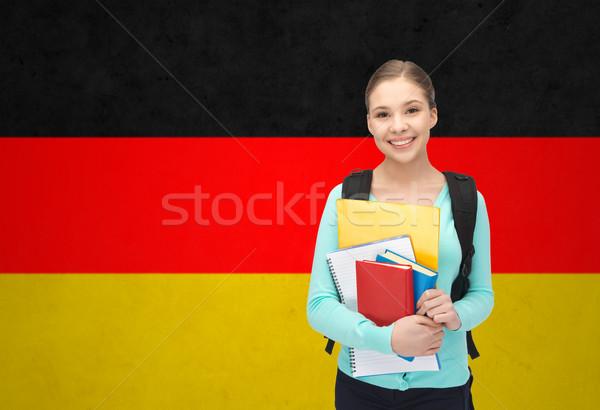 Feliz sonriendo estudiante nina libros Foto stock © dolgachov