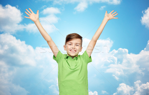happy boy in polo t-shirt raising hands up Stock photo © dolgachov