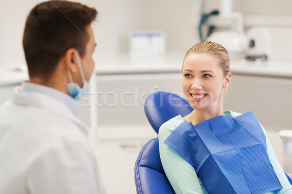 happy male dentist with woman patient at clinic Stock photo © dolgachov