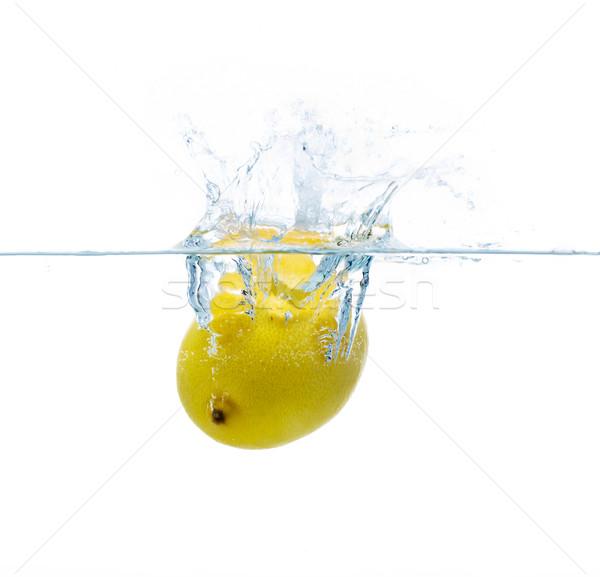 lemon falling or dipping in water with splash Stock photo © dolgachov