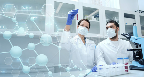 young scientists making test or research in lab Stock photo © dolgachov