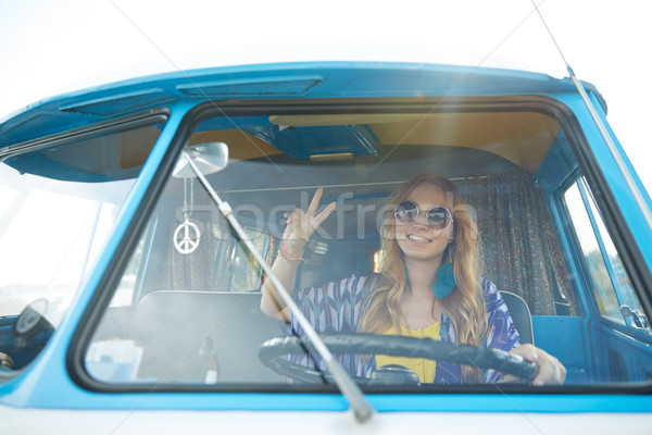 Stock photo: smiling young hippie woman driving minivan car