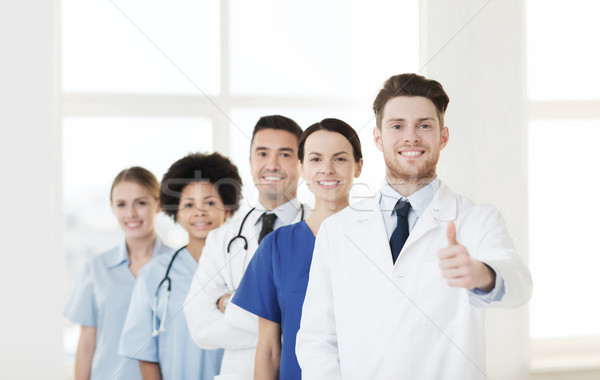 group of happy doctors at hospital Stock photo © dolgachov