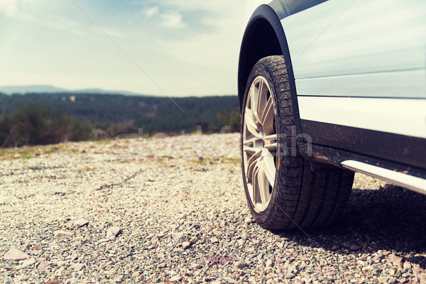 Stock photo: close up of dirty car wheel on cliff