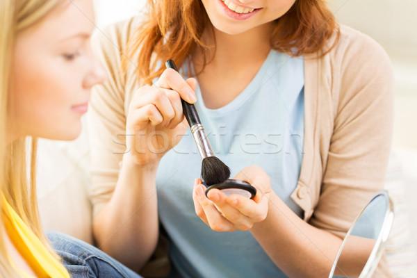Boldog nők sminkecset jelentkezik bőrpír szépség Stock fotó © dolgachov
