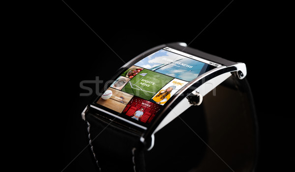 close up of smart watch with media application Stock photo © dolgachov