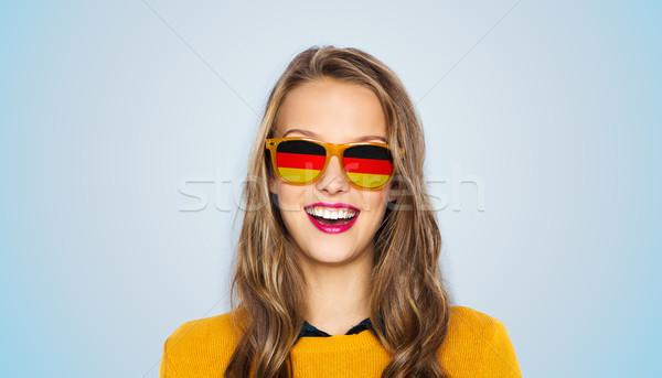 Feliz mulher jovem menina adolescente óculos de sol pessoas nacionalidade Foto stock © dolgachov