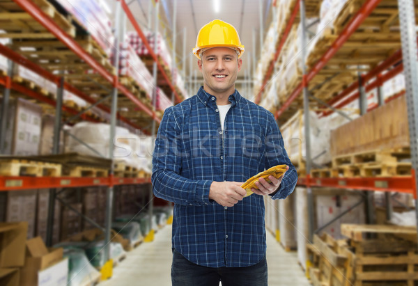 happy man in hardhat with gloves over warehouse Stock photo © dolgachov