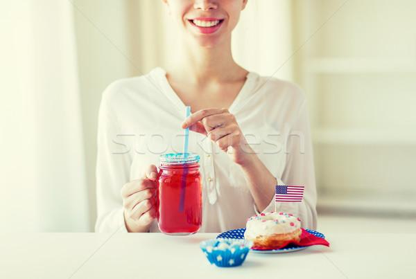 Boldog nő ünnepel amerikai nap ünneplés Stock fotó © dolgachov