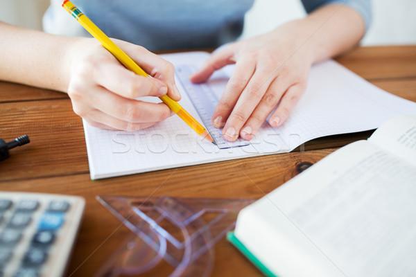 Közelkép kezek vonalzó ceruza rajz iskola Stock fotó © dolgachov