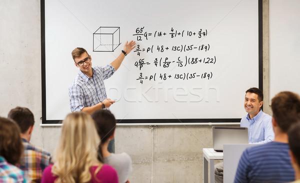 Csoport diákok tanár fehér tábla oktatás középiskola Stock fotó © dolgachov