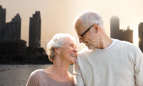 senior couple over dubai city street background Stock photo © dolgachov