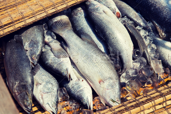 raw fish at asian street market Stock photo © dolgachov