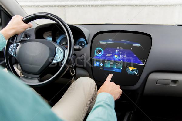 close up of man driving car with gps navigator map Stock photo © dolgachov