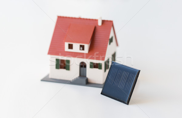 close up of house model and solar battery or cell Stock photo © dolgachov