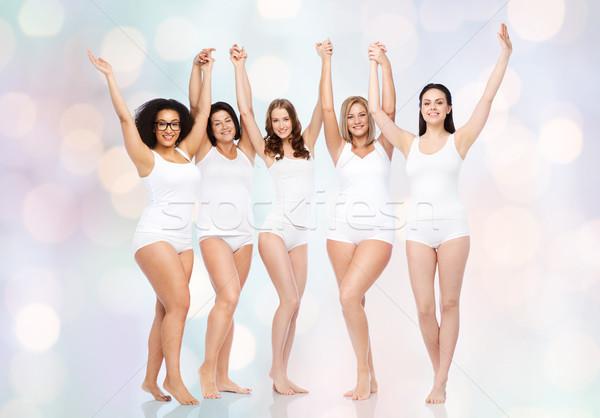 Grupo feliz diferente mujeres victoria Foto stock © dolgachov