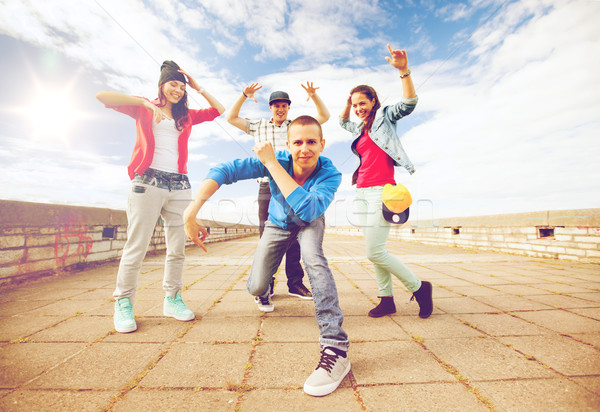 group of teenagers dancing Stock photo © dolgachov