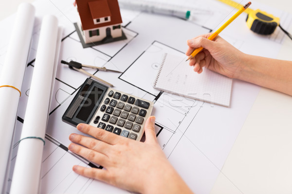 Stock photo: close up of architect hand counting on calculator