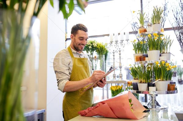 Fleuriste homme presse-papiers contre personnes Photo stock © dolgachov