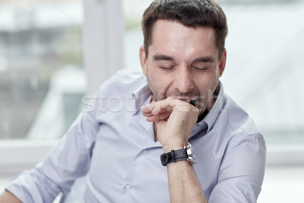 yawning tired man at home or office Stock photo © dolgachov