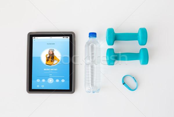tablet pc, dumbbells, fitness tracker and bottle Stock photo © dolgachov