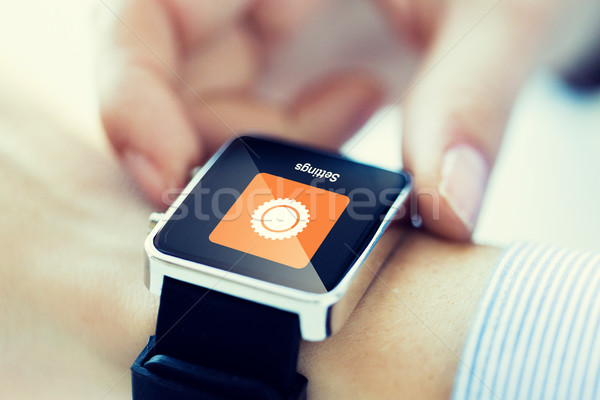 close up of hands setting smartwatch Stock photo © dolgachov