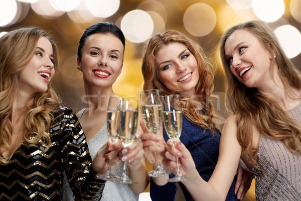 Szczęśliwy kobiet szampana okulary światła uroczystości Zdjęcia stock © dolgachov