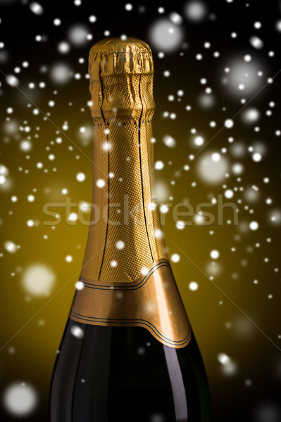 close up of champagne bottle with golden label Stock photo © dolgachov