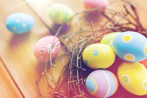 Renkli paskalya yumurtası yuva ahşap Paskalya Stok fotoğraf © dolgachov