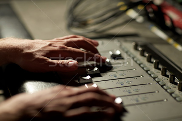 hands on mixing console in music recording studio Stock photo © dolgachov