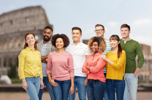 international group of happy people over coliseum Stock photo © dolgachov