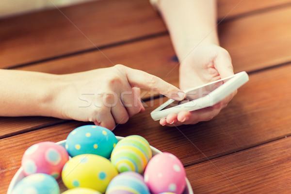 Stockfoto: Handen · paaseieren · smartphone · Pasen · vakantie