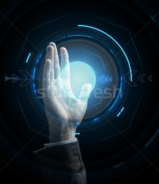 businessman hand with virtual projection Stock photo © dolgachov