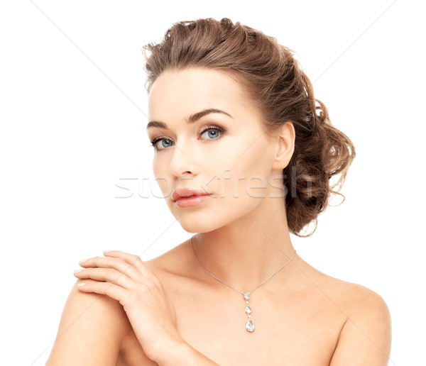 woman wearing shiny diamond necklace Stock photo © dolgachov