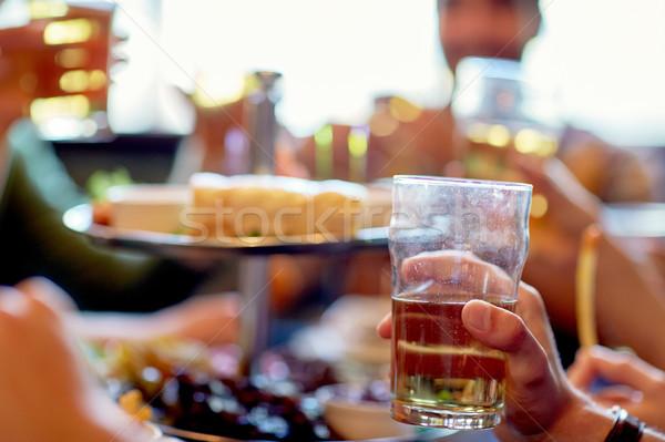 friends drinking beer at bar or pub Stock photo © dolgachov
