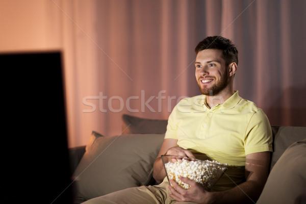幸せ 男 ポップコーン を見て テレビ 1泊 ストックフォト © dolgachov