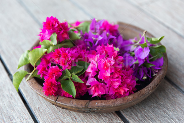 beautiful exotic flowers in wooden bowl Stock photo © dolgachov
