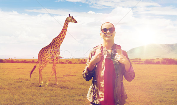 happy woman with backpack traveling in africa Stock photo © dolgachov