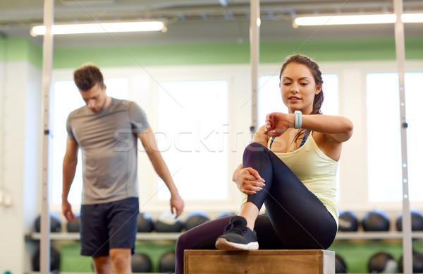 Uomo donna frequenza cardiaca palestra sport fitness Foto d'archivio © dolgachov