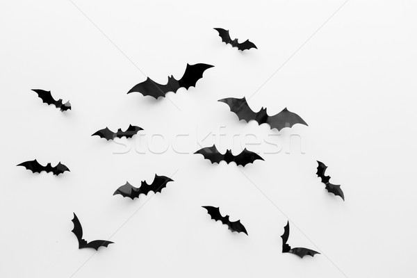black paper bats over white background Stock photo © dolgachov