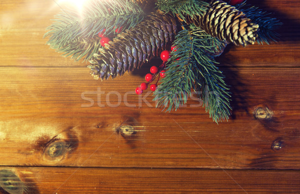 close up of fir branch with cones on wooden table Stock photo © dolgachov