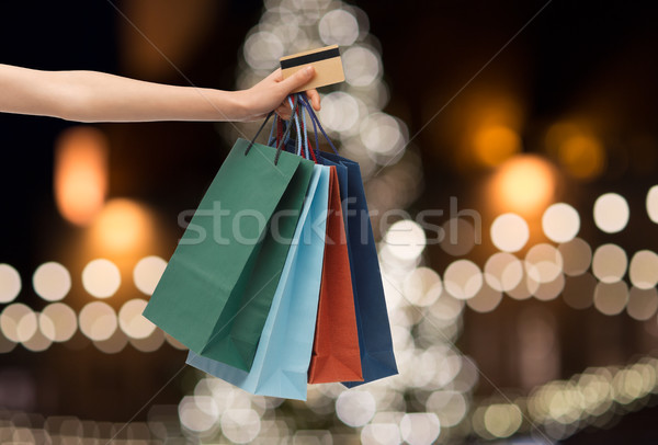 shopping bags and credit card in hand at christmas Stock photo © dolgachov