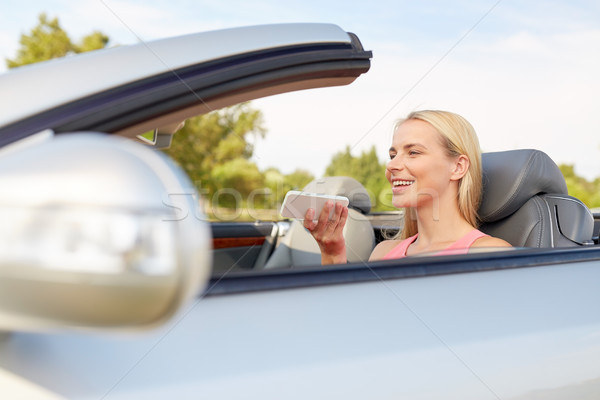 woman recording voice on smartphone at car Stock photo © dolgachov