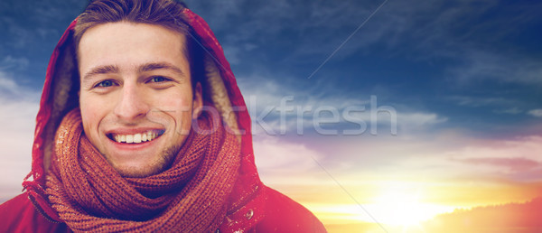 close up of happy man in winter jacket with hood Stock photo © dolgachov