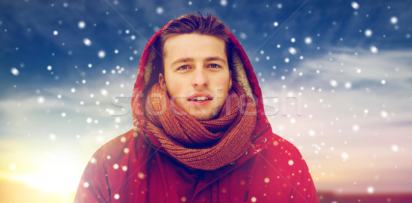 happy man in winter jacket with hood outdoors Stock photo © dolgachov