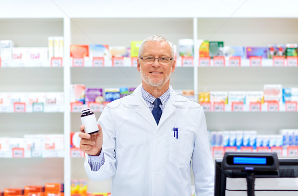 senior apothecary with drug at pharmacy Stock photo © dolgachov