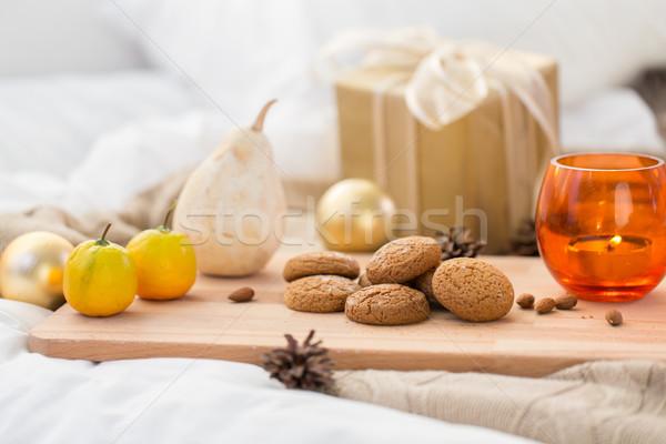 cookies, lemon, candle and christmas gift at home Stock photo © dolgachov