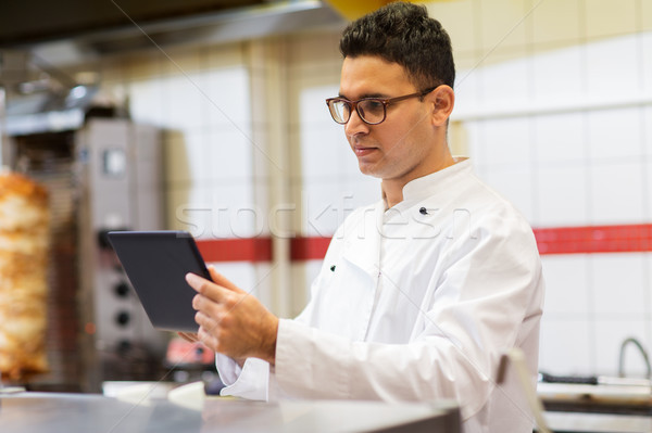 chef cook with tablet pc at restaurant kitchen Stock photo © dolgachov