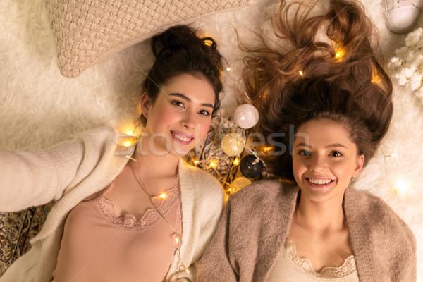 female friends taking selfie at home Stock photo © dolgachov