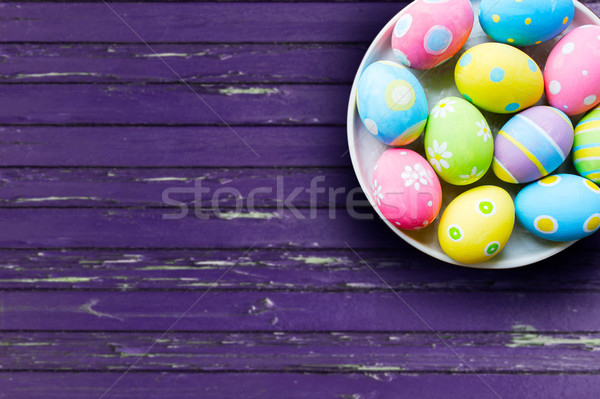 close up of colored easter eggs on plate Stock photo © dolgachov
